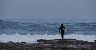 WOLLONGONG, AUSTRALIA Surfer looking at ocean waves before surfing