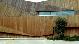 Wooden Building establishing shot modern architecture office business exterior: establishing shot of a modern architecture business building headquarters office exterior used by a company, facility, university, management or industry.