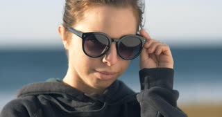 young adult model woman girl with sunglasses portrai