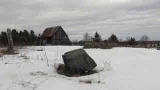 Decrepit barn in winter scene