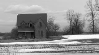 Decrepit house in black and white