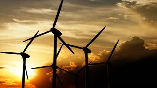 Beautiful landscape view of sunset and wind turbine field