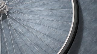Close-up bicycle wheel spinning, shop, background.