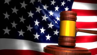 Gavel with american flag background.