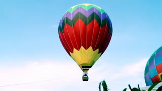 Hot air balloon festival, aircraft, gas, tourism.