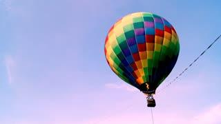Hot air balloon festival, aircraft, gas, tourism.