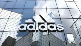 Editorial, Adidas AG logo on glass building.