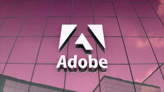 Editorial Adobe logo on glass building.