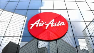 Editorial, AirAsia Berhad logo on glass building.