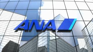 Editorial, All Nippon Airways Co., Ltd. logo on glass building.