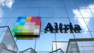 Editorial, Altria logo on glass building.