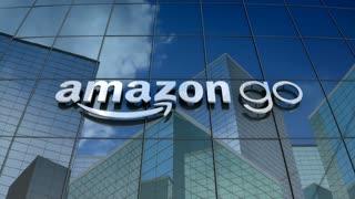 Editorial, Amazon Go logo on glass building.