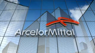 Editorial, ArcelorMittal S.A. logo on glass building.
