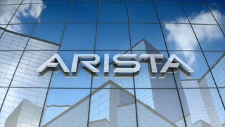Editorial, Arista Networks logo on glass building.