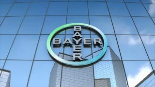 Editorial Bayer AG logo on glass building.
