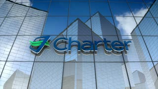 Editorial, Charter Communications Inc. logo on glass building.