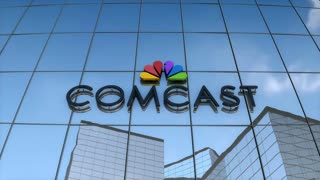 Editorial Comcast on glass building.