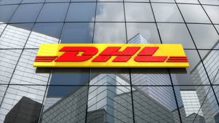 Editorial, DHL Express logo on glass building.