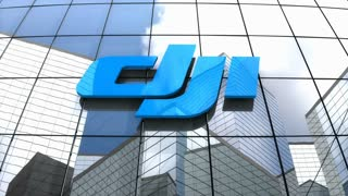 Editorial, DJI logo on glass building.