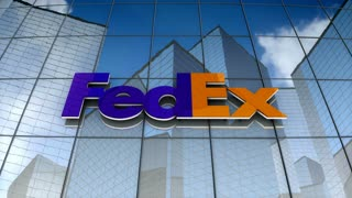 Editorial, FedEx Corporation logo on glass building.