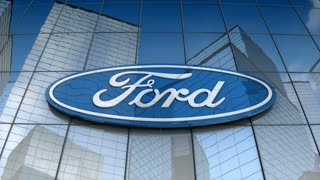 Editorial, Ford Motor Company logo on glass building.