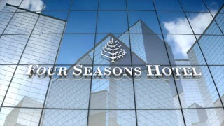 Editorial, Four Season Hotels Ltd logo on glass building.