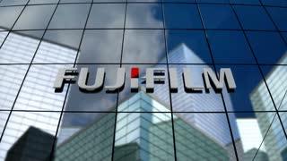 Editorial, Fujifilm Holdings Corporation logo on glass building.