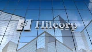 Editorial, Hilcorp Energy logo on glass building.