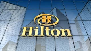 Editorial, Hilton logo on glass building.