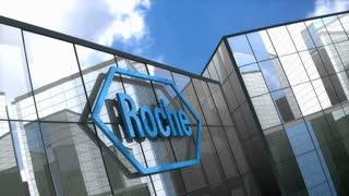 Editorial Hoffmann-La Roche logo on glass building.