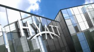Editorial, Hyatt Hotels Corporation logo on glass building.