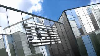 Editorial IBM logo on glass building.