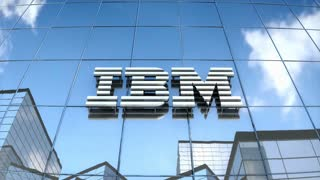 Editorial IBM logo on glass building.