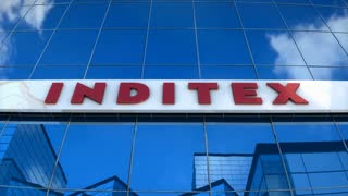 Editorial, INDITEX logo on glass building.