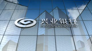 Editorial, Industrial Bank logo on glass building.