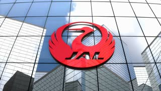 Editorial, Japan Airlines Co., Ltd. logo on glass building.