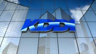 Editorial, KDDI Corporation Company Ltd logo on glass building.