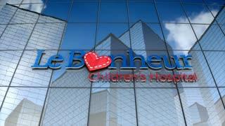 Editorial, Le Bonheur Children's Hospital logo on glass building.