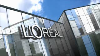 Editorial Loreal logo on glass building.