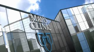 Editorial, Mayo Clinic logo on glass building.