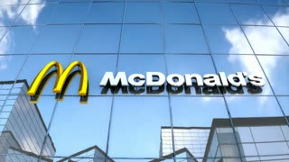 Editorial McDonalds logo on glass building.