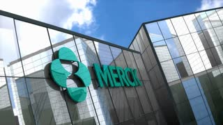 Editorial MERCK & Co logo on glass building.