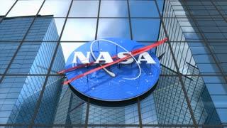 Editorial, NASA logo on glass building.