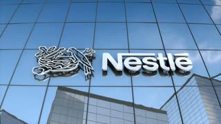 Editorial Nestle logo on glass building.