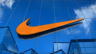 Editorial, NIKE logo on glass building.