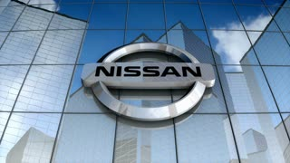 Editorial, Nissan Motor Company Ltd logo on glass building.