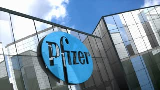 Editorial Pfizer logo on glass building.