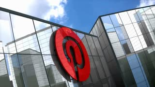 Editorial, Pinterest logo on glass building.