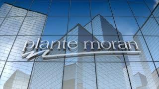 Editorial, Plante Moran logo on glass building.