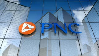Editorial, PNC Financial Services Group, Inc. logo on glass building.